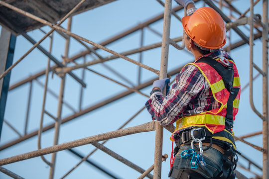 Worker on the  scaffolding construction site