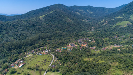 Aerial view to the mountaineous green hinterland of Tarituba on a sunny day, Green coast, Brazil