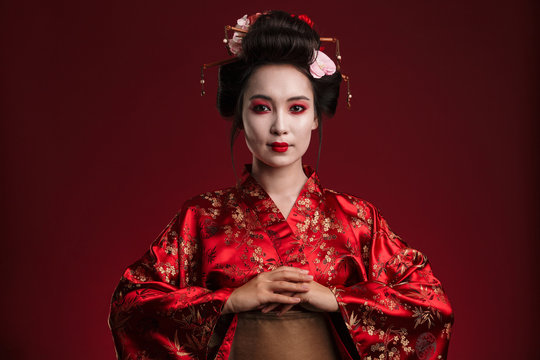 Image of beautiful young geisha woman in traditional japanese kimono