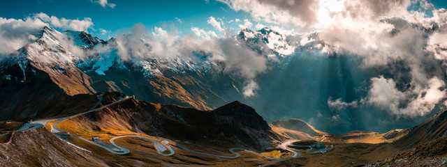 Spoed Fotobehang Landschap Panoramic Image of Grossglockner Alpine Road. Curvy Winding Road in Alps.