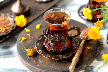 Photo sur Toile The Turkish traditional tea on a white wooden background