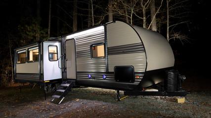 Camper trailer at a late fall campsite
