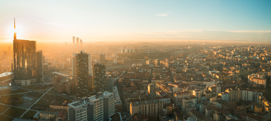 Spoed Fotobehang Milan Milan cityscape at sunset, panoramic view with new skyscrapers in Porta Nuova district. Italian landscape.