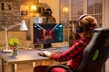 Professional video gamer female playing an online shooter game