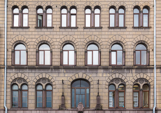 Many windows in a row on the facade of the urban historic building front view, Vyborg, Leningrad Oblast, Russia