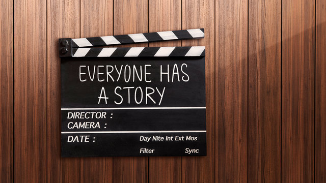 Everyone has a story text title on film slate place on wooden table.