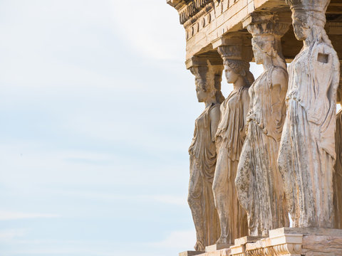 Row of Caryatid statues from Erechtheion temple in Acropolis of Athens with shallow depth of field
