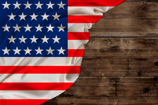 color national flag of modern state of USA, beautiful silk, background old wood, concept of tourism, economy, politics, emigration, independence day, copy space, template, horizontal