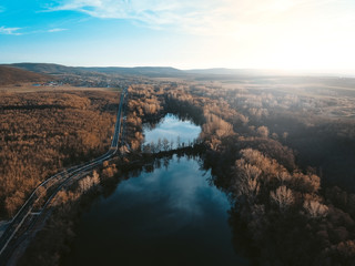 Photo Stands Deep brown sunrise over the lake, aerial photography