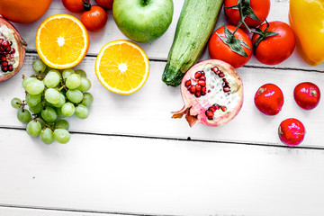 fresh vegetables and fruits for fitness dinner on white background top view mockup