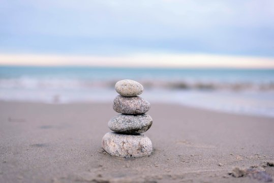 stacked rocks on calm beach
