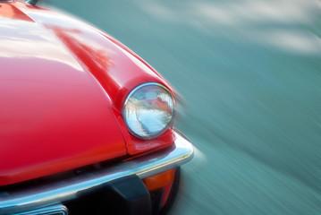 Fond de hotte en verre imprimé Vintage voitures antique car light red body of vintage car speeding on road