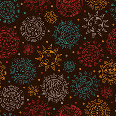 Colorful Ethnic solar symbols on dark background Seamless pattern. Ornamental Suns hand drawn doodles