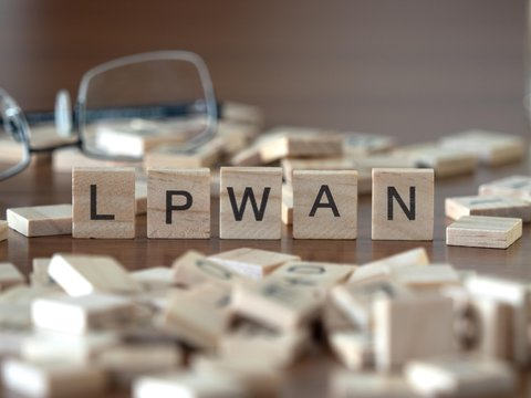 the acronym lpwan for Low-power wide-area networking concept represented by wooden letter tiles