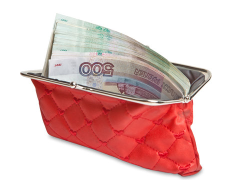 Open red wallet with Russian paper bills. Isolated on white background.