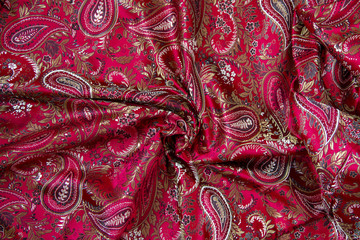 red paisley satin fabric background