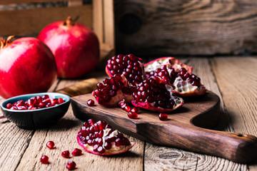 Fresh ripe whole pomegranates, opened pomegranate and seeds