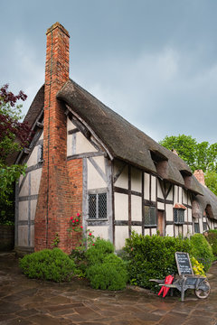 STRATFORD UPON AVON, ENGLAND - MAY 27, 2018: Anne Hathaway's (William Shakespeare's wife) famous thatched cottage and garden at Shottery, just outside Stratford upon Avon, England