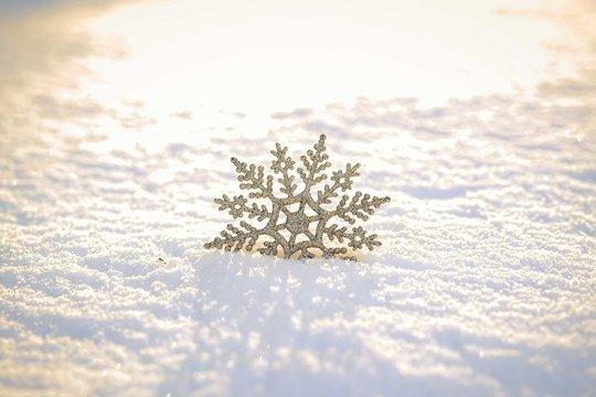 Christmas snowflake on the snow.