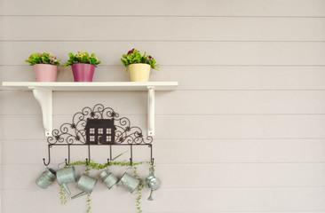 Wall Mural - The flower vase shelf on the white wooden floor.