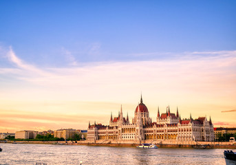 Poster Budapest The Hungarian Parliament Building located on the Danube River in Budapest Hungary at sunset.