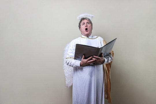 Man angel singing in the choir