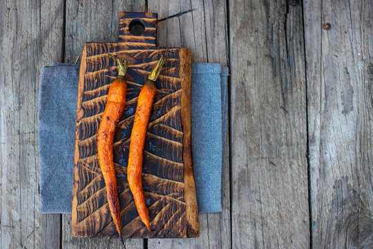 Baked roasted grilled whole carrot with spices