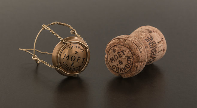 Cork and top from Moet and Chandon Brut Imperial champagne on a grey background