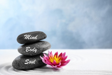 Garden Poster Lotus flower Stones with words Mind, Body, Soul and lotus flower on white sand. Zen garden