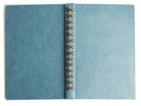 Open old book with vintage light blue cover isolated on white, top view