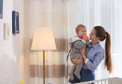 Teen nanny with cute little baby at home