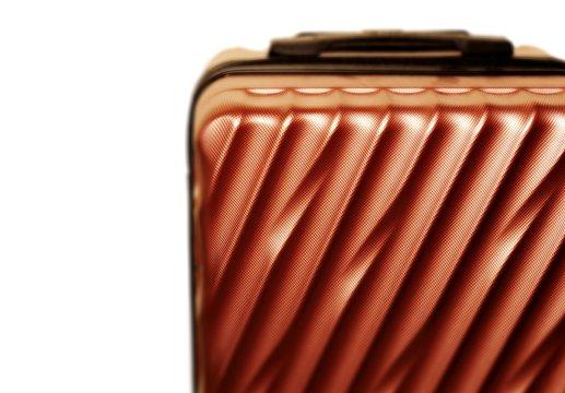 Closeup metallic luggage pattern texture background. Copper, macro.