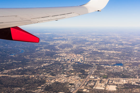 Airplane view of Austin, Texas downtown and surrounding area on a sunny day