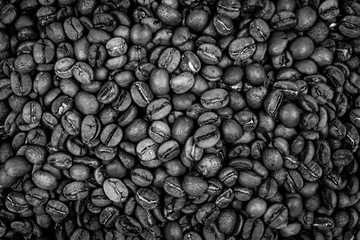 High angle closeup shot of fresh black coffee beans