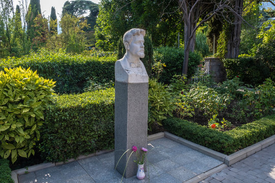 Bust of the Russian writer Anton Pavlovich Chekhov in the courtyard of the summer house-museum in Yalta.