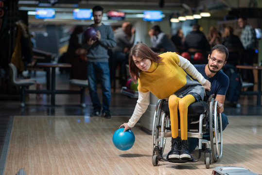 Disabled woman in a wheelchair bowling