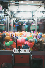 Claw Machine Arcade Game Filled With Brightly Colored Stuffed Toys