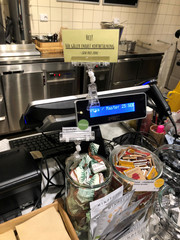A sign informing that cash payments are not accepted is seen at a cafe in Stockholm