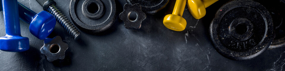 Sport and fitness background with dumbbells