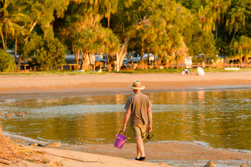 A man returning after fishing in Seventeen Seventy, Queesland, Australia.