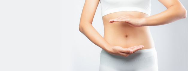 Obraz Close up woman hands made protect shape stomach isolated on white background banner size.health care digesting concept. - fototapety do salonu