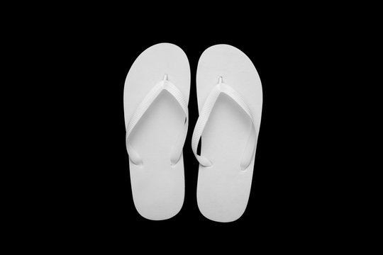 Blank white flip flops on a black cutted background. Mock-up.