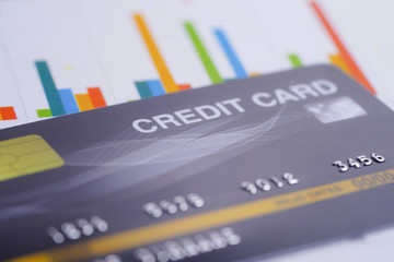 Credit card model on chart and graph spreadsheet paper. Finance development, Banking Account, Statistics, Investment Analytic research data economy, Stock exchange trading, Business company concept..