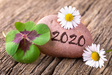 Happy New Year 2020 - Greeting Card - Natural decoration with stone, four-leaf clover and daisy flowers