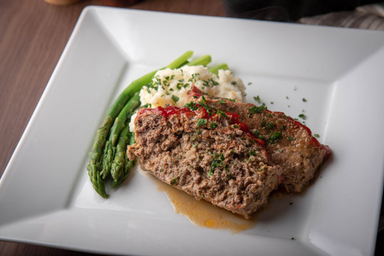 meat loaf with mashed potato and asparagus