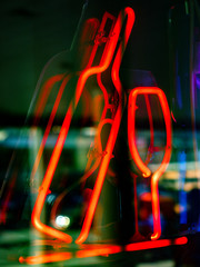 Neon sign in the form of a bottle and a glass
