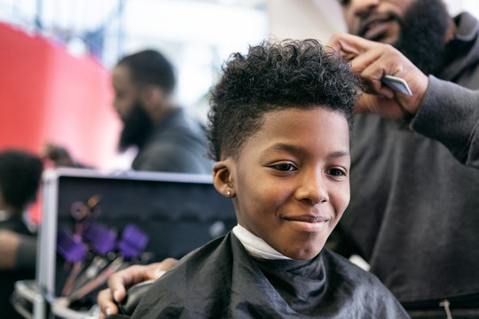 Barber: Smiling Young Man Getting A Haircut