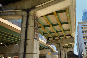 Crumbling concrete and rust under the Gardiner Expressway in downtown Toronto
