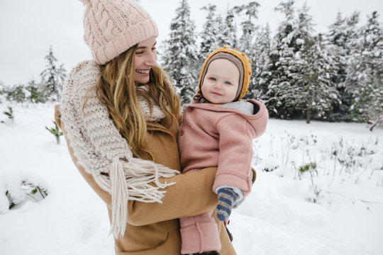 Mom and baby together in the snow