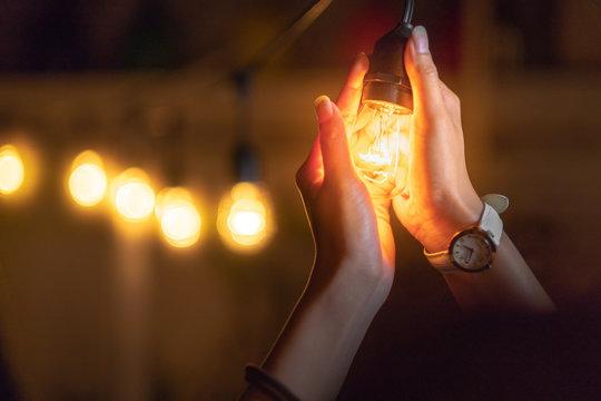 Girl holding a lightbulb